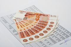 Cash Russian money for the signed document. Royalty Free Stock Photos