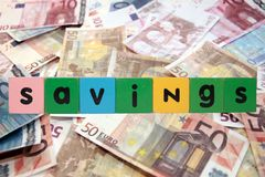 Cash savings in toy letters Royalty Free Stock Photography