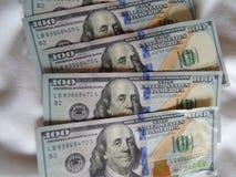 Cash on the sheet. Secret traveling dollars Royalty Free Stock Photo