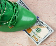 Cash and Shoes. Royalty Free Stock Images