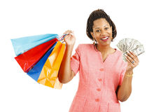 Cash for Shopping Spree. Beautiful african-american woman with cash to spend on a shopping spree. Isolated on white stock photo