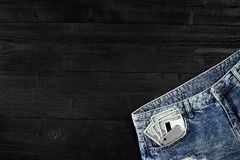 Cash and smart in your jeans pocket. Still life. Stock Image