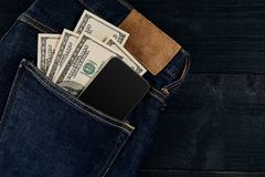 Cash and smart in your jeans pocket. Still life. Stock Images