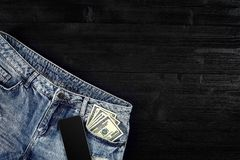 Cash and smart in your jeans pocket. Still life. Royalty Free Stock Photos