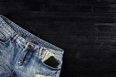 Cash and smart in your jeans pocket. Still life. Royalty Free Stock Image