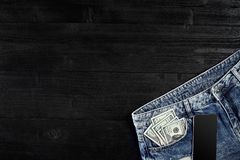 Cash and smart in your jeans pocket. Still life. Stock Photos