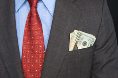 Cash in suit pocket Stock Photos