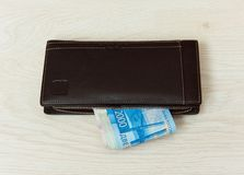The workplace of business people. Laptop and money. Payment by Bank card. stock images