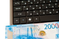 The workplace of business people. Laptop and money. Payment by Bank card. royalty free stock photos