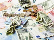 Cash on table : dollars, euro, rubl broken money. All in Stock Image