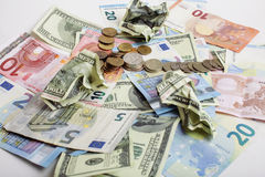 Cash on table isolated: dollars, euro, rubl broken money. All in mess, global crisis concept Stock Photos