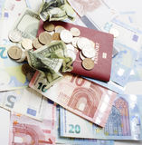 Cash on table isolated: dollars, euro, rubl broken money. All in mess, global crisis concept Stock Images