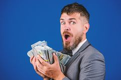 Cash transaction business. Man happy winner rich hold pile of dollar banknotes blue background. Easy cash loans. Businessman got cash money. Win lottery stock photos