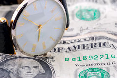Cash and watch Stock Photo