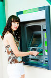 Cash withdrawal. Woman to withdraw cash from an ATM Stock Photo