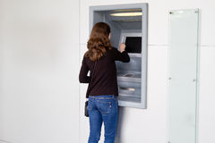 Cash Withdrawal. Woman at an atm machine cash withdrawal Stock Photos