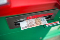 Cash withdrawal. Euro banknotes in ATM Stock Images