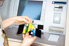 Cash withdrawal with Visa card Stock Photo