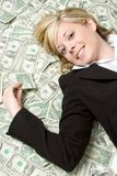 Cash Woman. Beautiful woman laying in cash royalty free stock photos