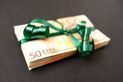 Cashback. Stash of 50 euro banknotes with a nice green ribbon around them for your financial, bonus, cashback, gifts and presents copy - note, that the money is Stock Images