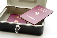 Cashbox with passport Stock Image