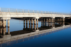 Cashen road bridge over cold blue river reflected Royalty Free Stock Image