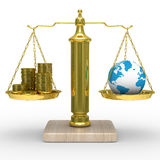 Cashes and the globe on scales Stock Photography