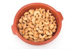 Cashew. In a clay dish stock photography