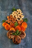 Cashew almonds dried apricots and dried figs in the form of a bouquet of flowers stock photography