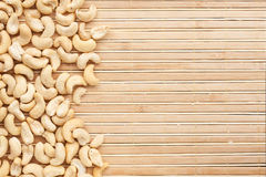 Cashew is on a bamboo mat Stock Images