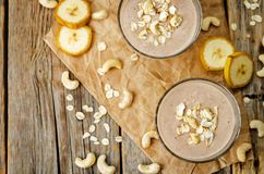 Cashew banana cocoa oats smoothie. On a wood background. the toning. selective focus stock image