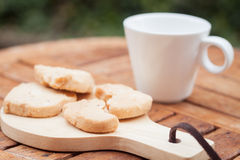 Cashew cookies with coffee cup Stock Photo