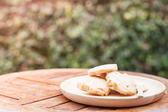 Cashew cookies on wooden plate Royalty Free Stock Photo