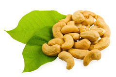 Cashew and green leaves. On white background Royalty Free Stock Image