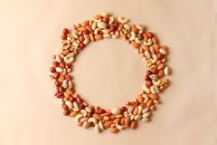 Cashew, hazelnuts, walnuts, almonds in circle form. Top view or flat-lay. Copy space stock photos