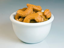 Cashew nut. Pile of cashew nuts in gradient background stock photography