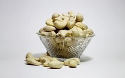 Cashew nut in bowl on white background royalty free stock images