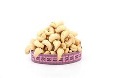 Cashew (nut) and meter Royalty Free Stock Photo