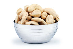 Cashew nuts. Cup of cashew nuts isolated on white background royalty free stock photography