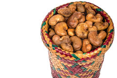 Cashew nuts in basket on white background Royalty Free Stock Photography