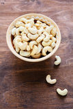 Cashew nuts in a bowl on wooden background Stock Images