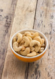 Cashew nuts in the bowl on wooden table Stock Photography