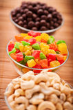 Cashew nuts, candied peanuts Stock Images