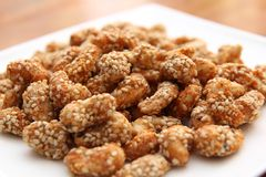Cashew nuts coated  with sesame seeds and spices Stock Photography