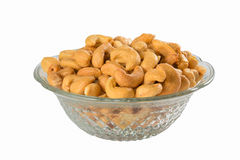 Cashew nuts in a crystal bowl Stock Photos