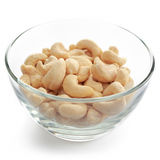Cashew nuts. Glass bowl with cashew nuts isolated on white background royalty free stock image