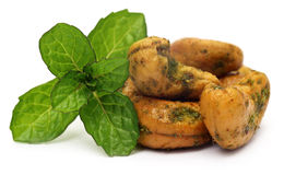 Cashew nuts with green mint leaves Royalty Free Stock Photos