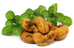 Cashew nuts with green mint leaves Royalty Free Stock Images