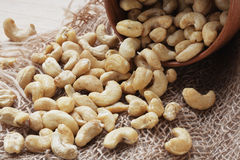 Cashew nuts. Handful of cashew nuts on bagging background Stock Image