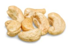 Cashew nuts heap on white background. Heap nuts cashew yellow group white background royalty free stock photos